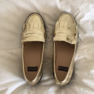 Gold loafers